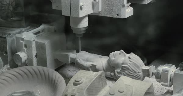 CNC mill in the process of creating a wooden figurine Royalty-free stock video