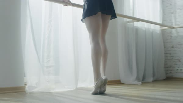 Close-up shot of ballerina's legs stretching and warm up routine in the morning Royalty-free stock video