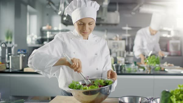 Female Cook Prepares Salad in a Big Modern Kitchen. Royalty-free stock video