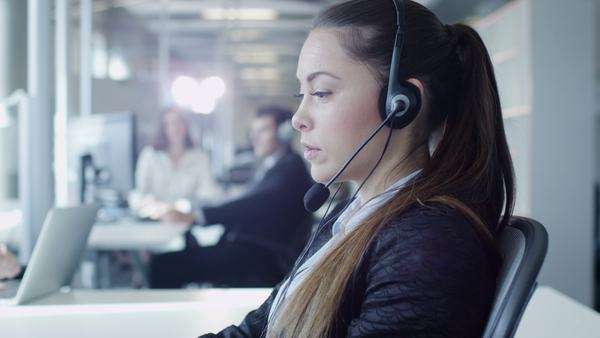 Female customer support worker in call center. Royalty-free stock video