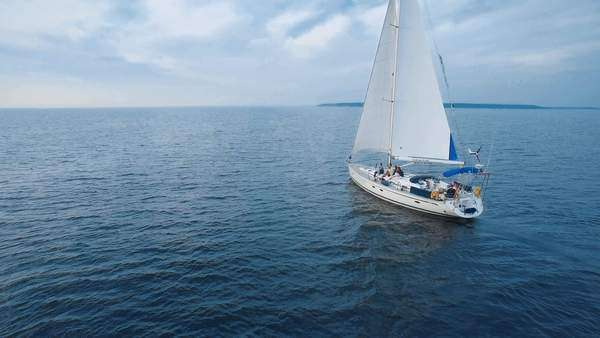 Aerial drone shot of a sailing boat in the sea during daytime. Royalty-free stock video
