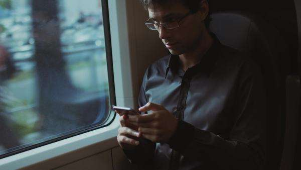 Man using phone during traveling on train Royalty-free stock video