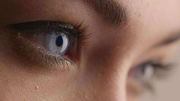 Close-up shot of woman blue eye with light day make-up. Royalty-free stock video