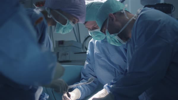 Medical team performing surgical operation in modern operating room Royalty-free stock video