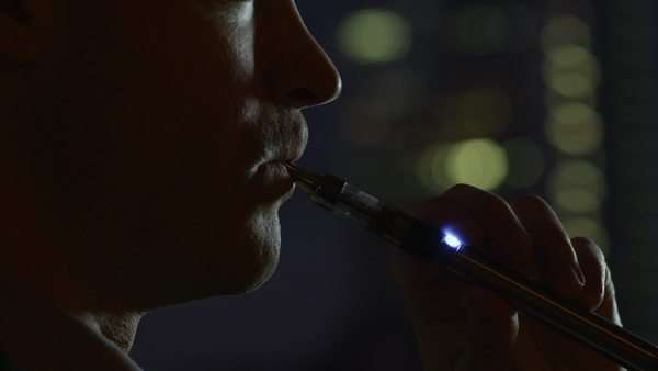 Smoking electronic cigarette during the evening close-up Royalty-free stock video