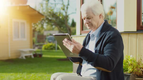 Senior Man Uses Tablet Computer Outdoors. Royalty-free stock video