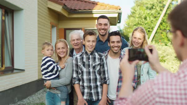 Man Taking Outdoor Photos of His Big Family. Royalty-free stock video