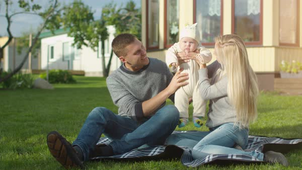 Young Father and Mother Play with Their Baby. Royalty-free stock video