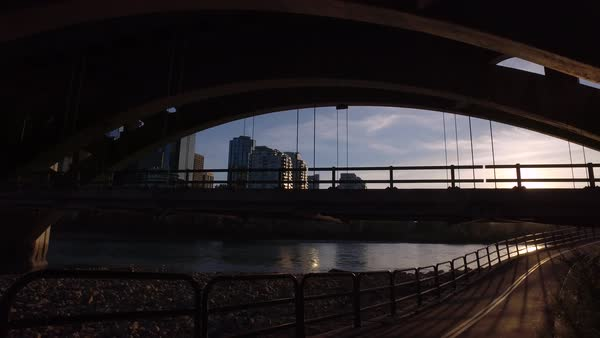Wide shot of a car crossing the Centre Street Bridge in Calgary, Alberta, Canada Royalty-free stock video