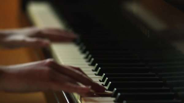 Close-up of woman's hands playing piano Royalty-free stock video