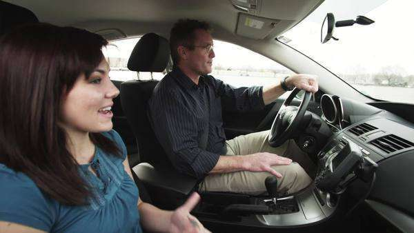 Medium shot of father and daughter talking in car Royalty-free stock video