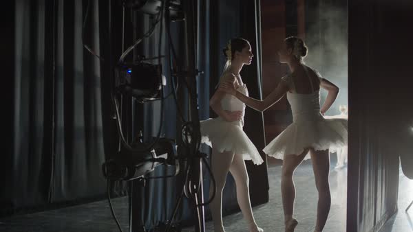 Medium panning shot of ballerinas waiting backstage Rights-managed stock video