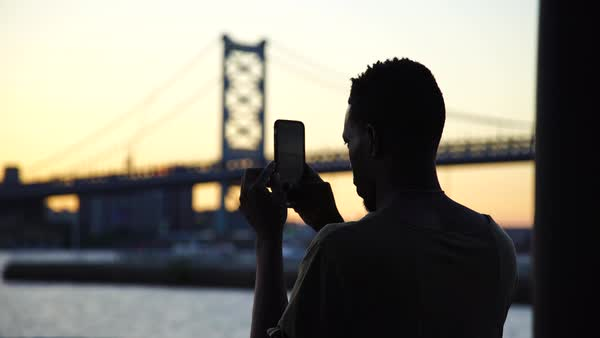 Medium shot of a man making pictures with his cell phone Royalty-free stock video
