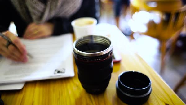 Close up shot of a cup of hot coffee on a table Rights-managed stock video