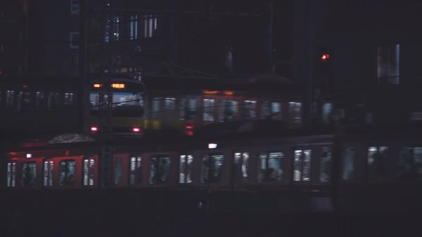 Panning shot of  the train lines at Ochanomizu Station, Tokyo, Japan, at night Royalty-free stock video