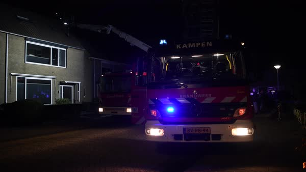 Fire Engines Of The Dutch Fire Department At A Chimney Fire In A