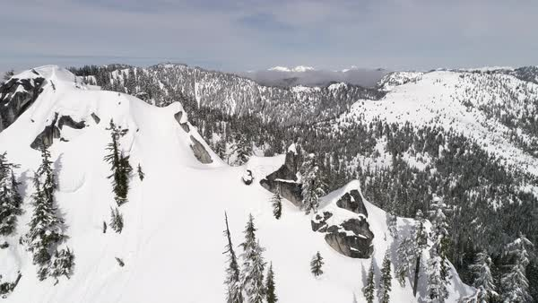 Slow Rotating Aerial of Cascade Mountain Range Summit with Cliffs of Powder Snow in Washington State Royalty-free stock video