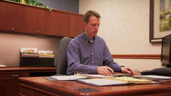 A finance officer works at his desk with a tablet PC Royalty-free stock video