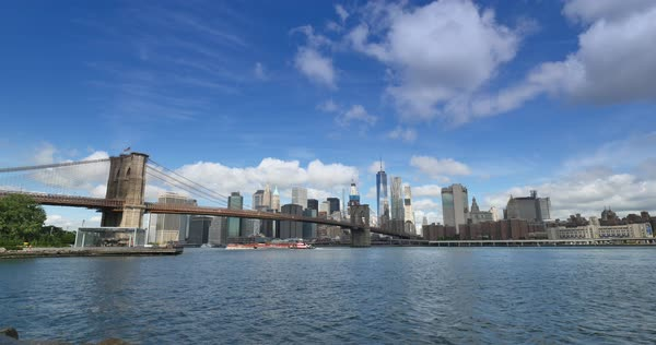 A wide angle view of the New York Skyline and the Brooklyn Bridge as seen from Brooklyn.  	 Royalty-free stock video