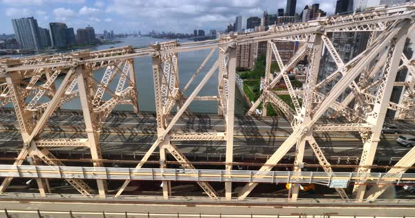 NEW YORK - Circa July, 2016 - A aerial side view of traffic on the Ed Koch Queensboro Bridge as seen from the Roosevelt Tramway. Royalty-free stock video