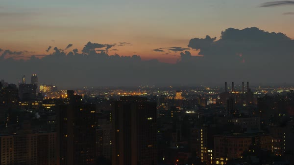 A summer sunrise timelapse shot over Midtown Manhattan.	 	 Royalty-free stock video