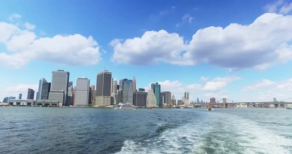 A daytime view of the lower Manhattan skyline as seen from the East River Ferry on the way to Governors Island.	 	 Royalty-free stock video