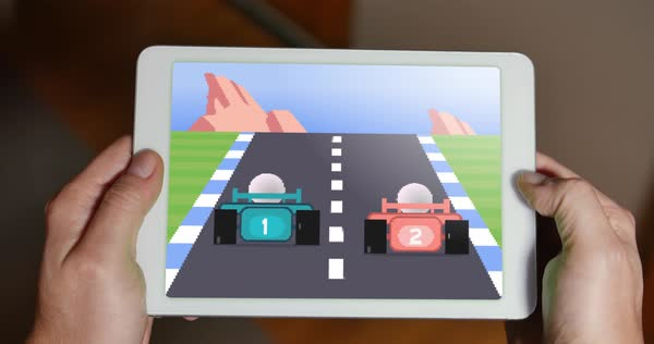 A person plays a retro 8-bit racing video game on a tablet PC.    Royalty-free stock video