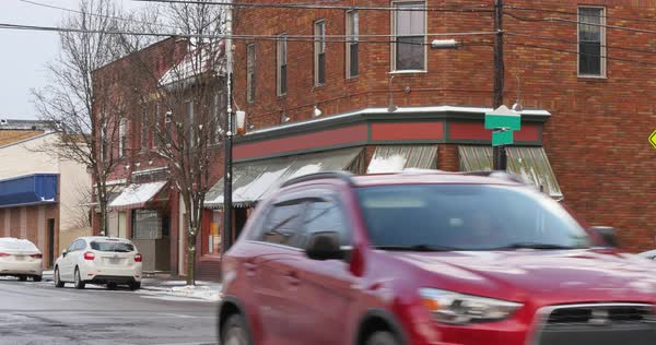 A wintry establishing shot of a corner bar or restaurant in a small town Royalty-free stock video