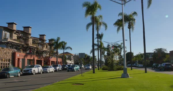 A daytime establishing shot of a typical street on the upscale Coronado Island in San Diego.  	 Royalty-free stock video