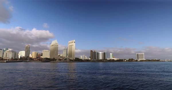 A wide, dramatic daytime establishing shot of the San Diego city skyline as seen from the bay.	 	 Royalty-free stock video