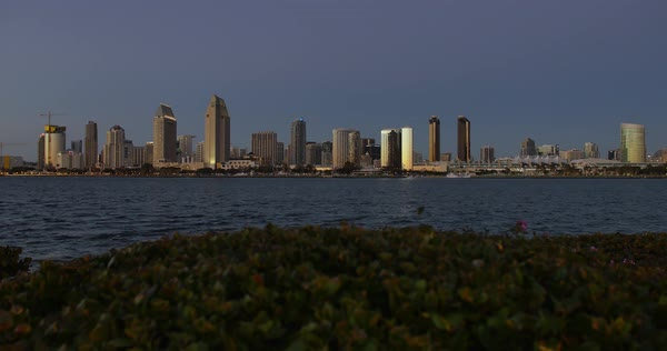 SAN DIEGO, CA - Circa February, 2017 - A picturesque wide slow dollying establishing shot of the San Diego skyline at dusk.  Royalty-free stock video