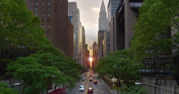 "A cinematic wide evening establishing shot over 42nd Street in New York City during ""Manhattanhenge."" Royalty-free stock video"