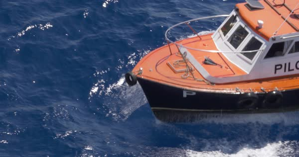 A high angle aerial view of the bow of a small pilot boat as it travels in Havana Port Bay. Royalty-free stock video