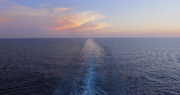 A slow motion dusk view of the wake behind a large cruise ship at sea Royalty-free stock video