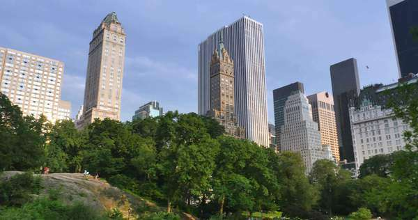 An late afternoon establishing shot of the buildings surrounding Central Park in Manhattan. Royalty-free stock video
