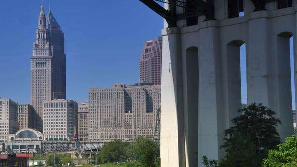 CLEVELAND, OH - Circa August, 2014 - The Cleveland skyline as seen from the Cuyahoga River on a summer day. Royalty-free stock video
