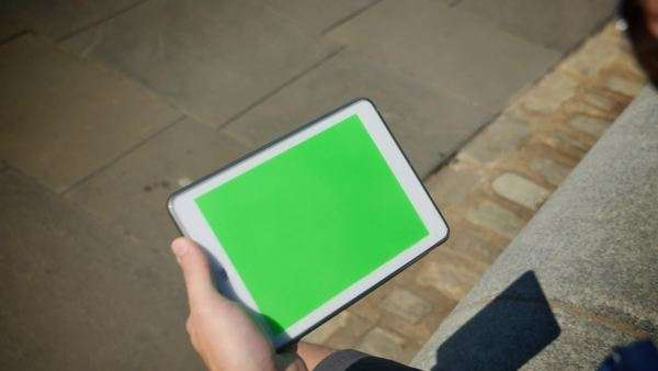 A man holds a green screen tablet PC. Royalty-free stock video