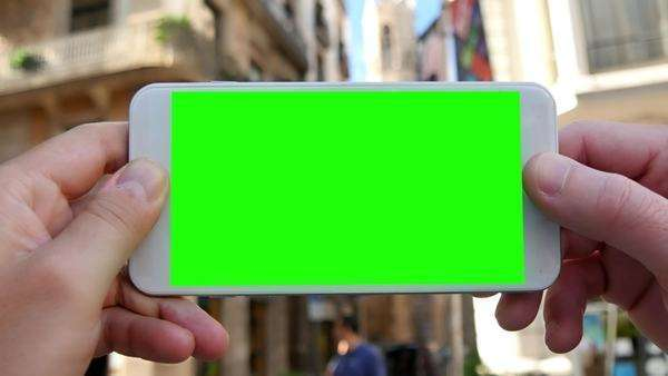 Holding a green screen smartphone in Barcelona's Gothic District. Royalty-free stock video
