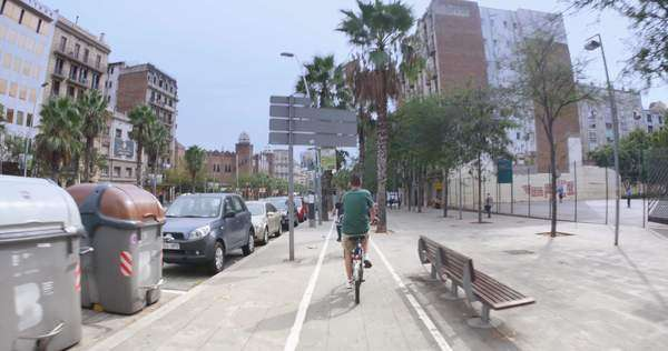 BARCELONA, CATALONIA, SPAIN - Circa October, 2014 - Tourists bike through the historic downtown district of Barcelona, Spain. Royalty-free stock video