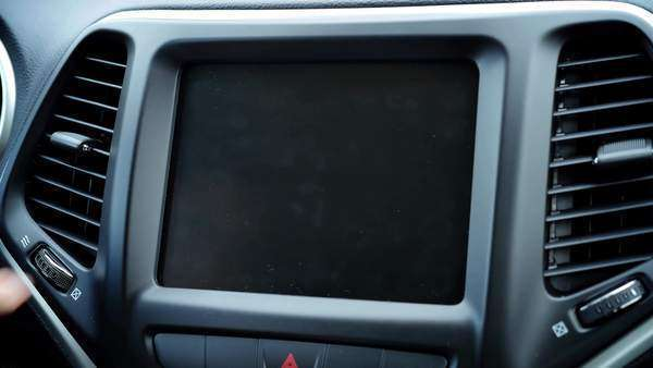 A close up of view a person choosing an option on their in-dash touchscreen entertainment unit. With optional luma matte. Royalty-free stock video