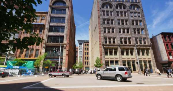 PITTSBURGH, PA - A daytime establishing shot of the intersection of Liberty and 7th Avenues in downtown Pittsburgh, PA. Royalty-free stock video
