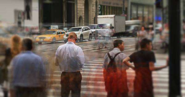 NEW YORK CITY - June, 2015 - A timelapse view of the hustle and bustle of pedestrians and traffic at a Manhattan intersection. Royalty-free stock video