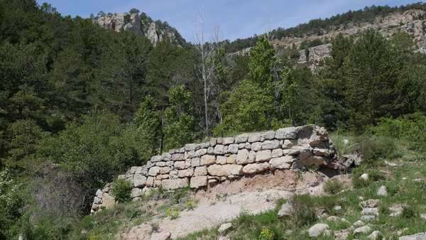 The ruin of a stone wall, perhaps a foundation, stand in the depopulated Sierra de Gudar region of Spain. Royalty-free stock video