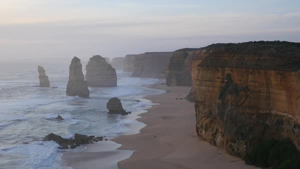 A late evening view of cliffs and sea stacks in Australia's Twelve Apostles Marine National Park. Royalty-free stock video