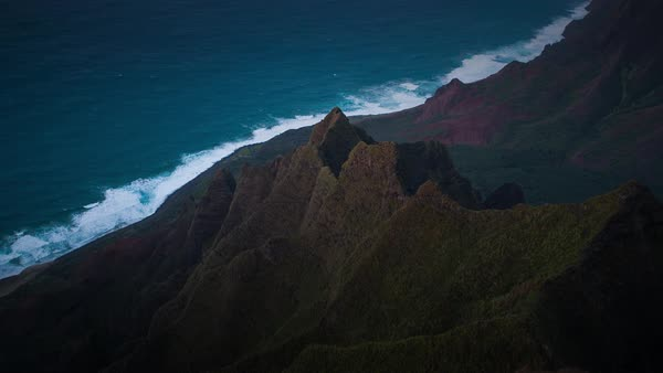 Kauai, Napali Coast, shadow moving sunset timelapse, taken from above. Rights-managed stock video
