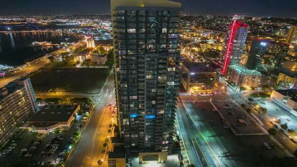 Timelapse static shot of San Diego Downtown. Birds eye view cityscape at night. Rights-managed stock video