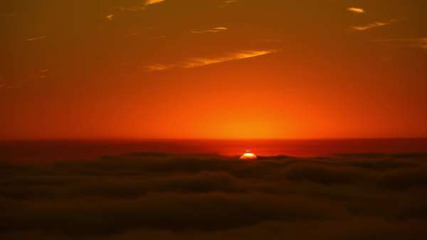 Timelapse static shot of sunset above the fog in Santa Barbara Royalty-free stock video