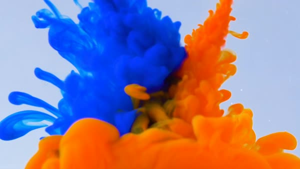 Macro concept of multicolored inks falling and mixing in water abstract  background stock footage