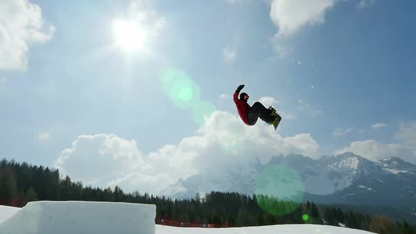 Snowboard slow motion, snowboarder jumping backside Royalty-free stock video