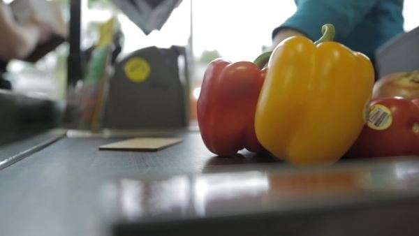 Close-up shot of bell peppers on at the check-out counter Royalty-free stock video